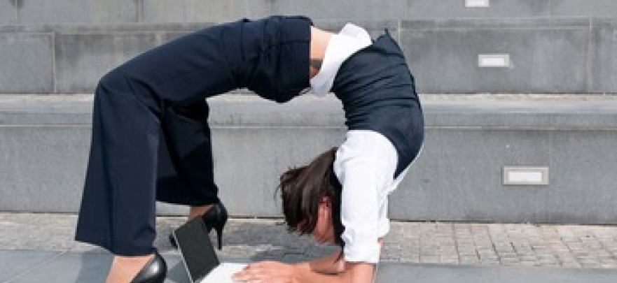 Lady bending over backwards to work